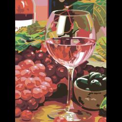 Натюрморт с бокалом розового вина